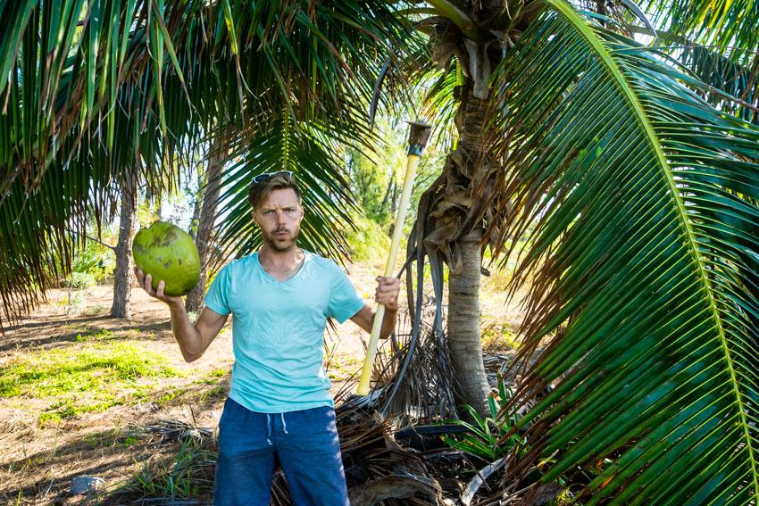 jason cutting down coconuts