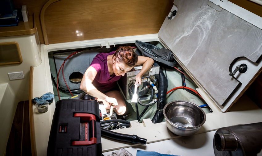 nikki wynn cleaning the sailboat engine
