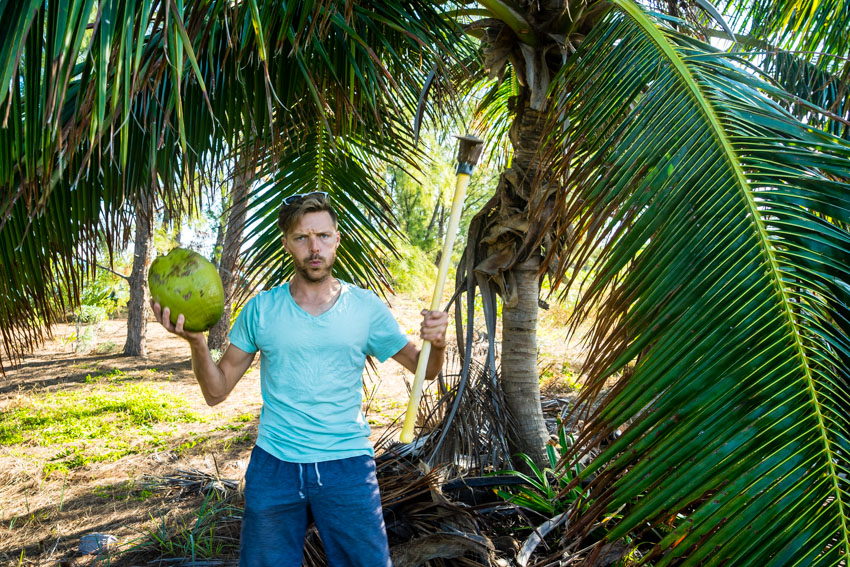 jason cutting down coconuts