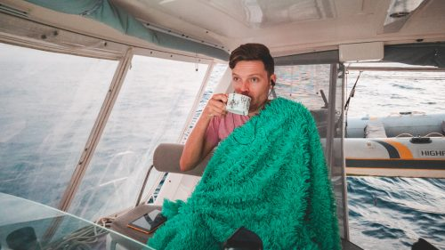 just a man with a blanket and hot tea at sea