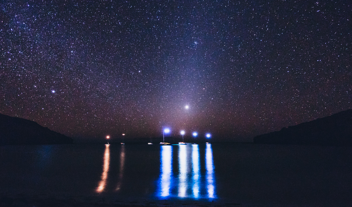 starry night with sailboats anchored in the marquesas french polynesia
