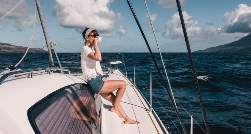 nikki wynn sipping coffee while sailing the marquesas