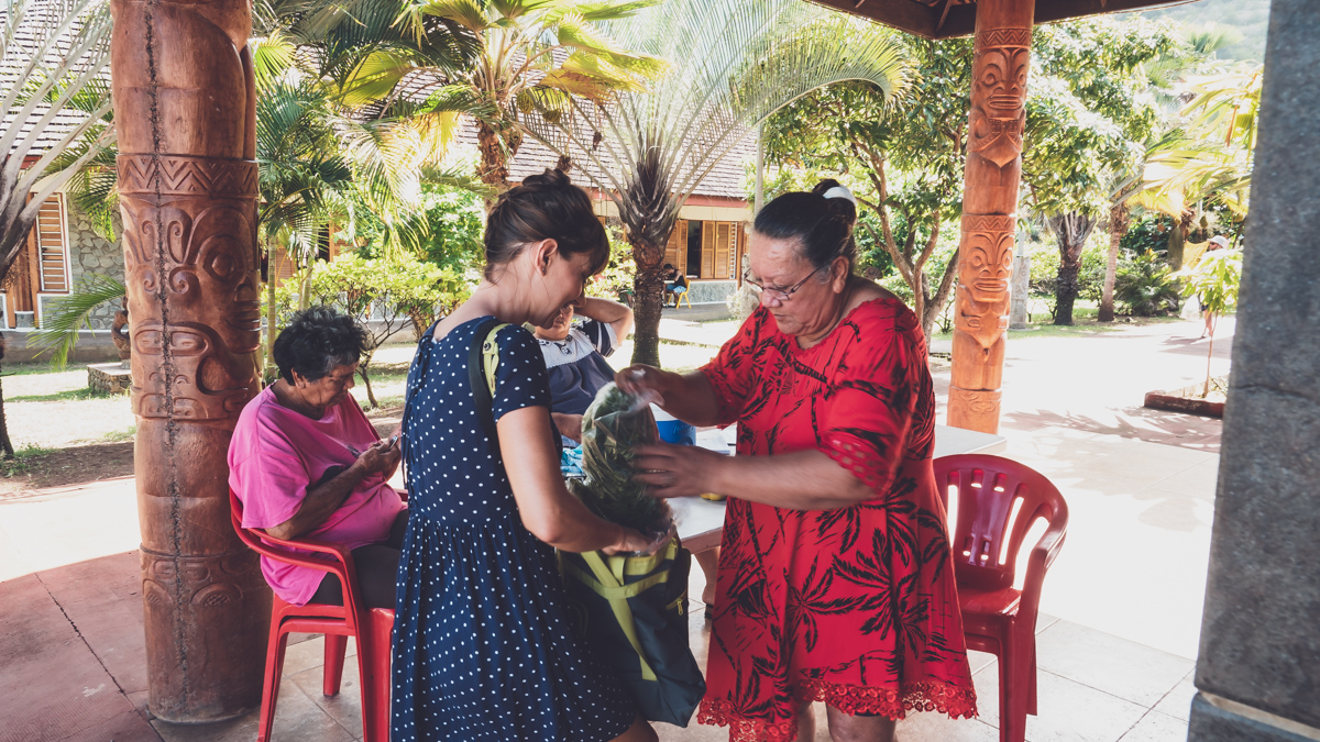 marquesan woman helping Nikki with fresh produce