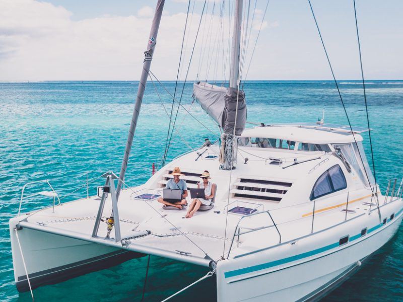 digital nomad working while sailing around the world