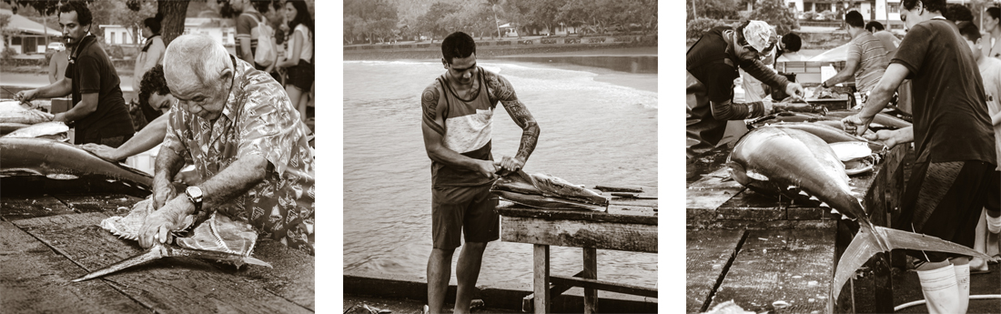 fishermen cleaning and filleting their catch Nuku Hiva Marquesas