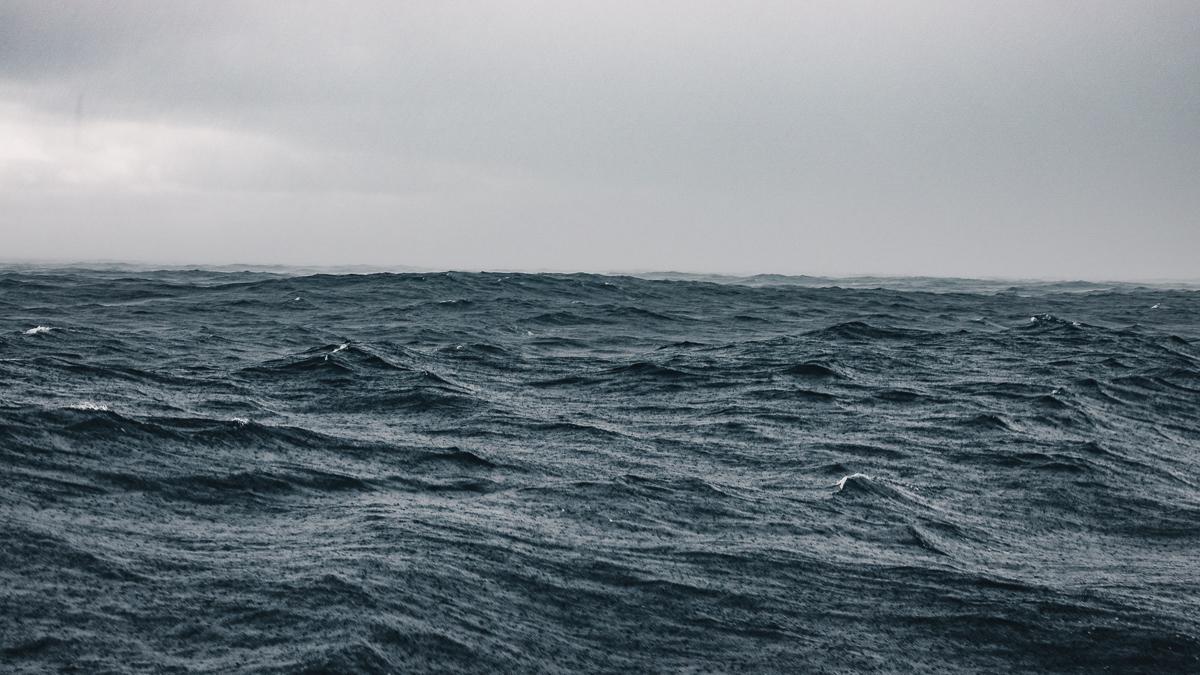 rain storm at sea while sailing the pacific ocean