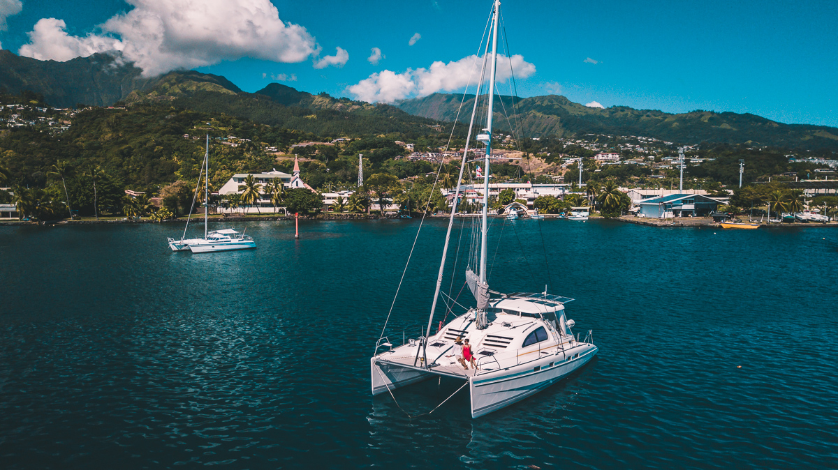 s/v curiosity at anchor in Tahiti with Jason and Nikki Wynn on deck
