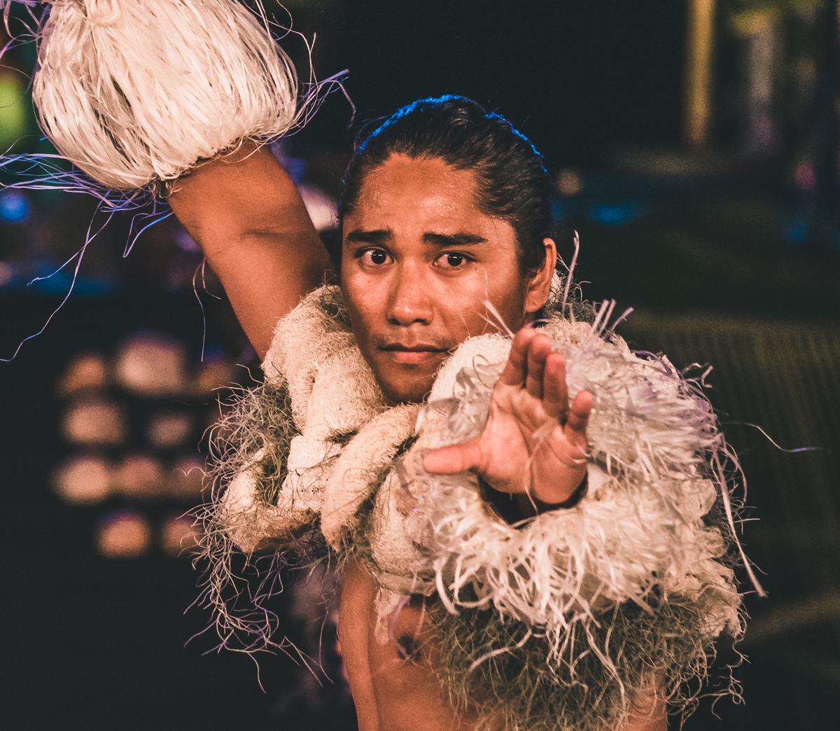 beautiful tahitian man performing cultural dance