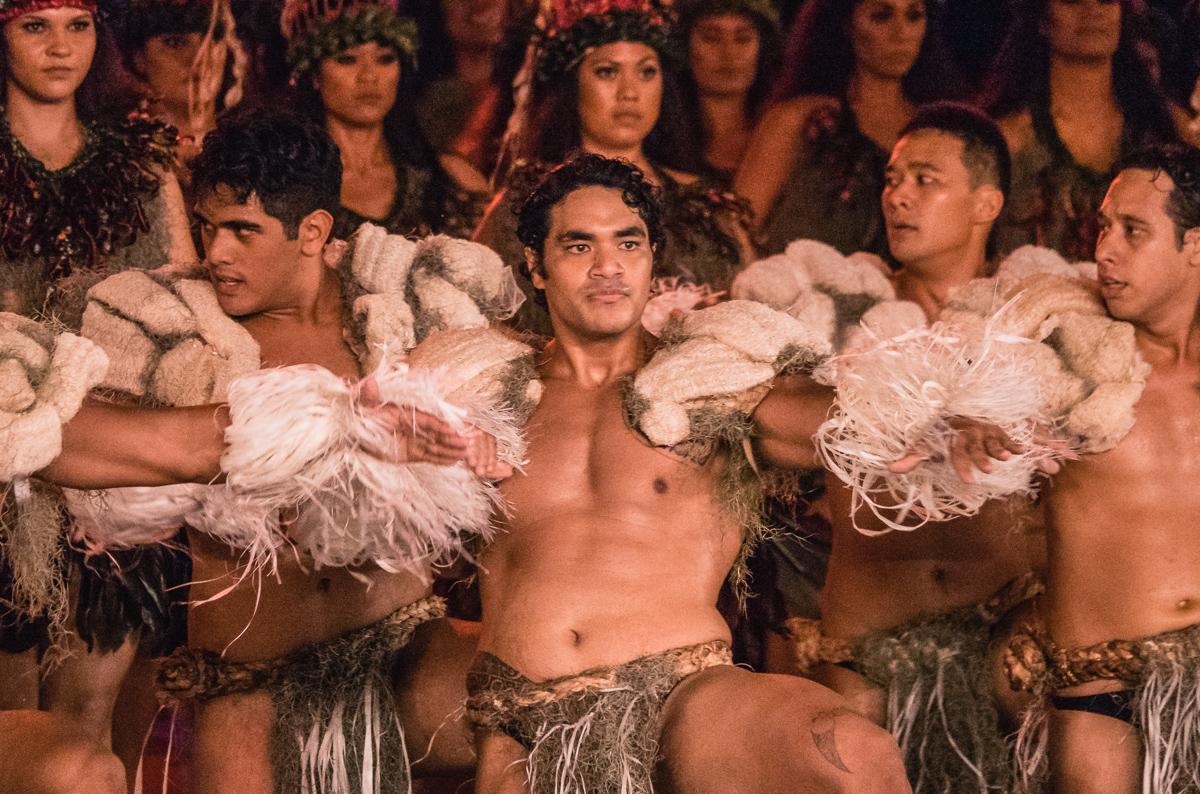 tahitian men performing cultural dance