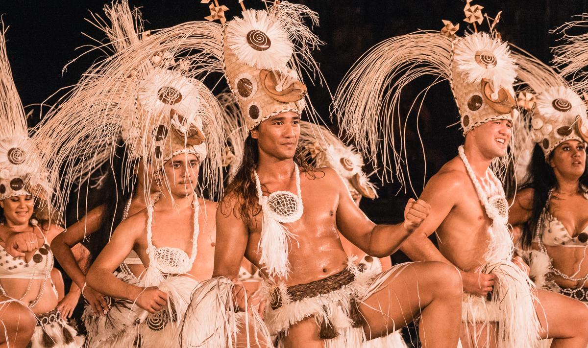 beautiful tahitian man performing exotic cultural dance
