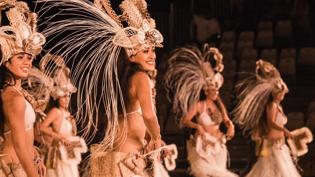 beautiful tahitian woman performing cultural dance