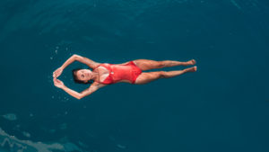 nikki wynn floating in bora bora blue water