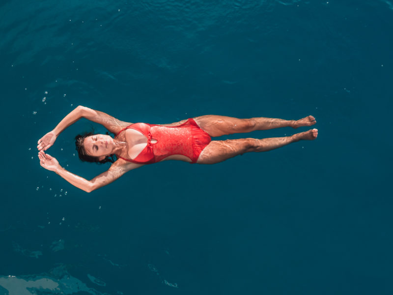 nikki wynn floating in bora bora blue water