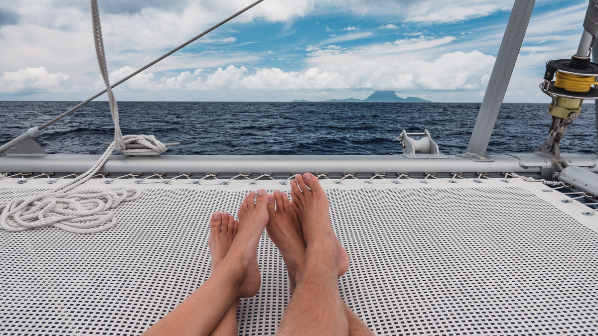 nikki and jason wynn cuddling while sailing to bora bora