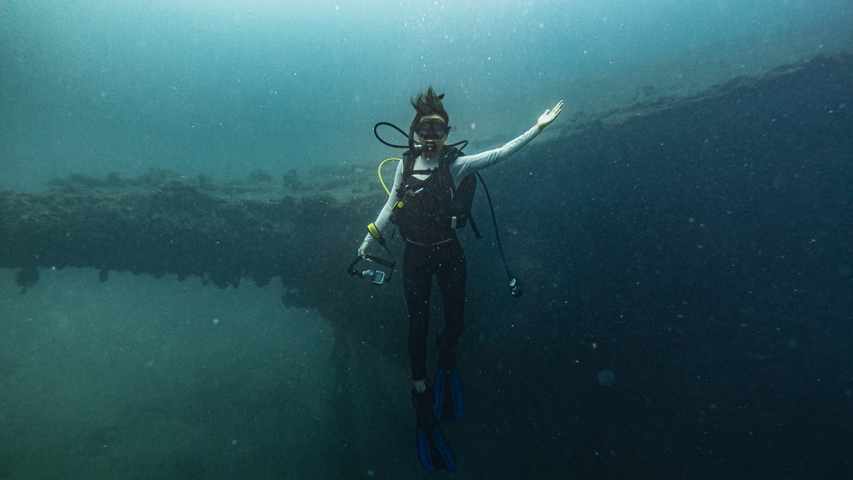 nikki wynn scuba diving a shipwreck in raiatea french polynesia