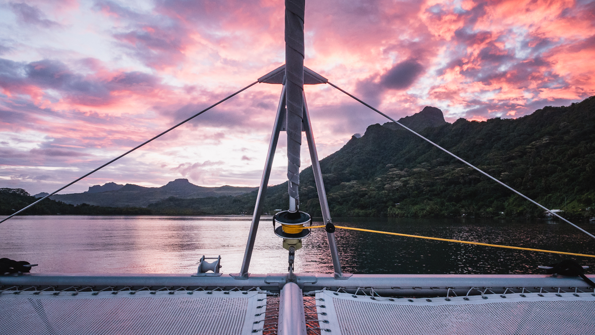beautiful sunset at anchor on a catamaran in raiatea french polynesia