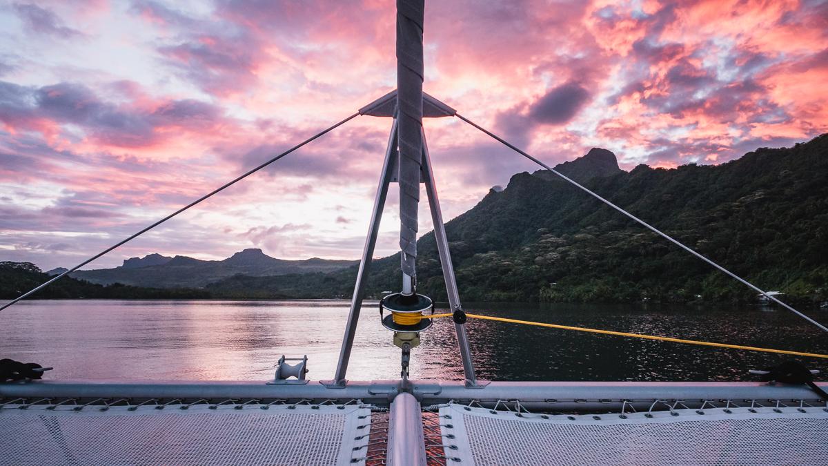 beautiful sunset at anchor on a catamaran in raiatea french polynesia