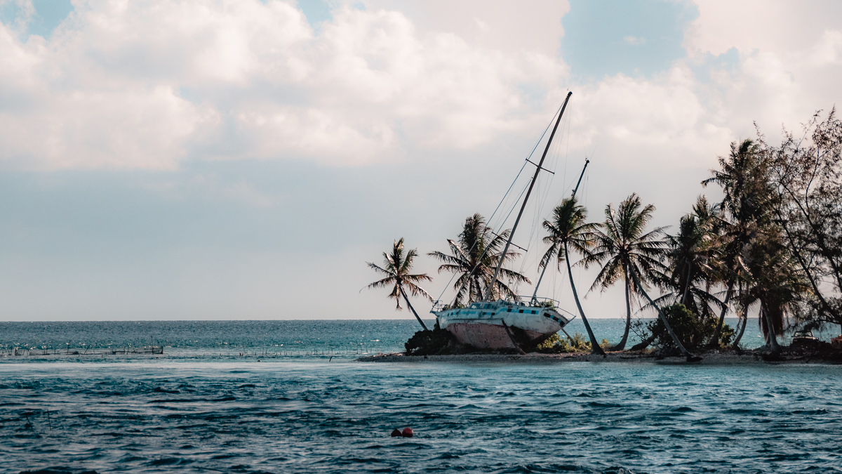 sailboat washed up on reef in tuamotu