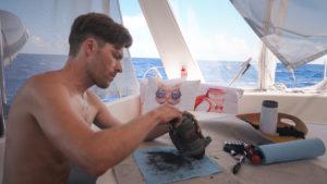 jason wynn working on sailboat engine