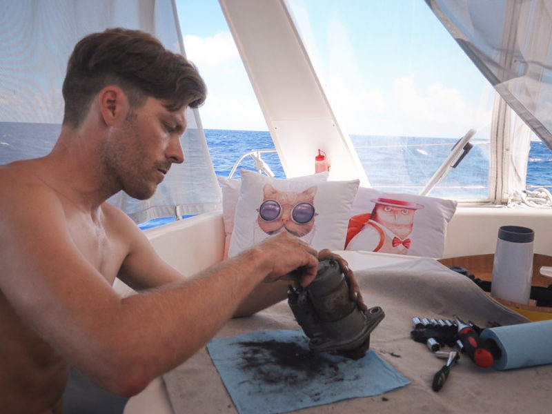 jason wynn working on sailboat engine