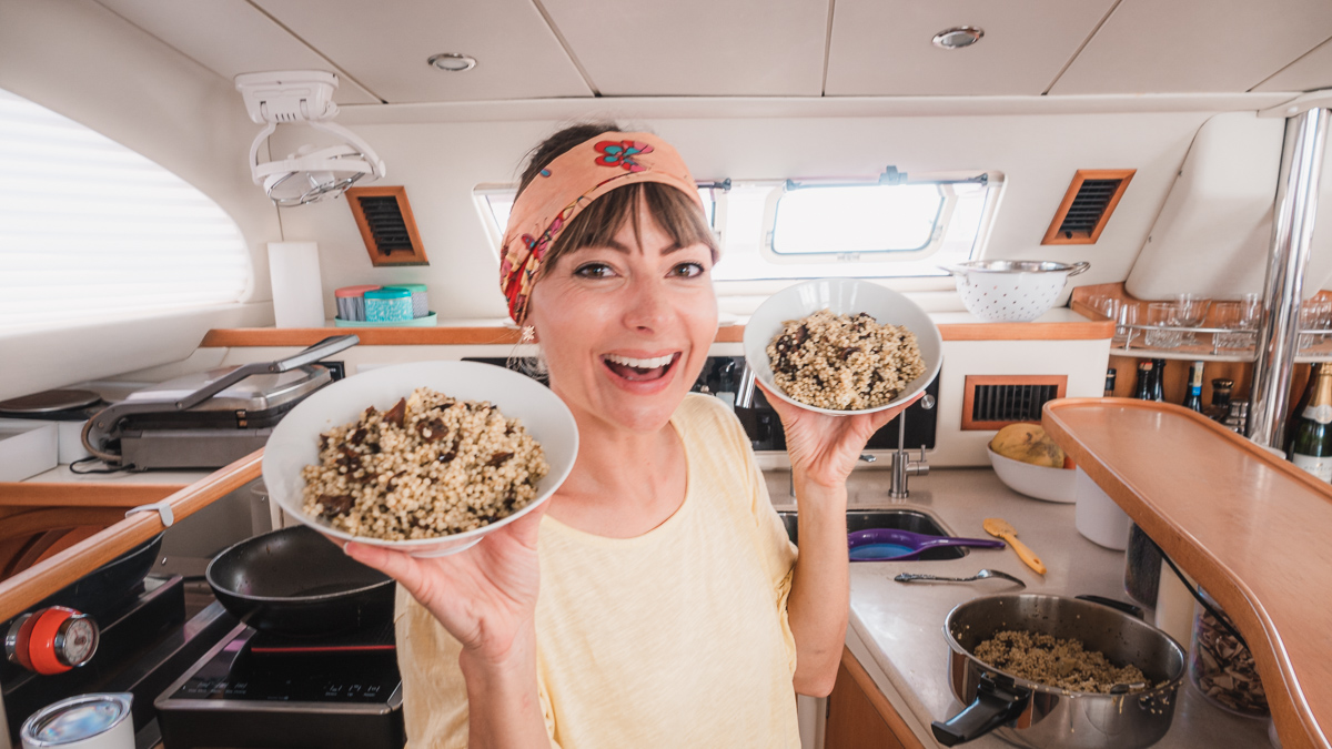 nikki wynn in the galley of s/v curiosity cooking up pasta