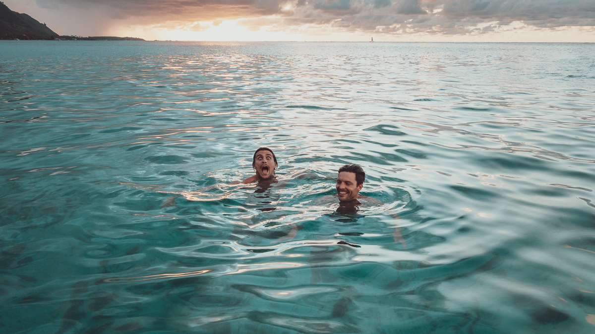 jason and jacob swimming in Tahiti french polynesia
