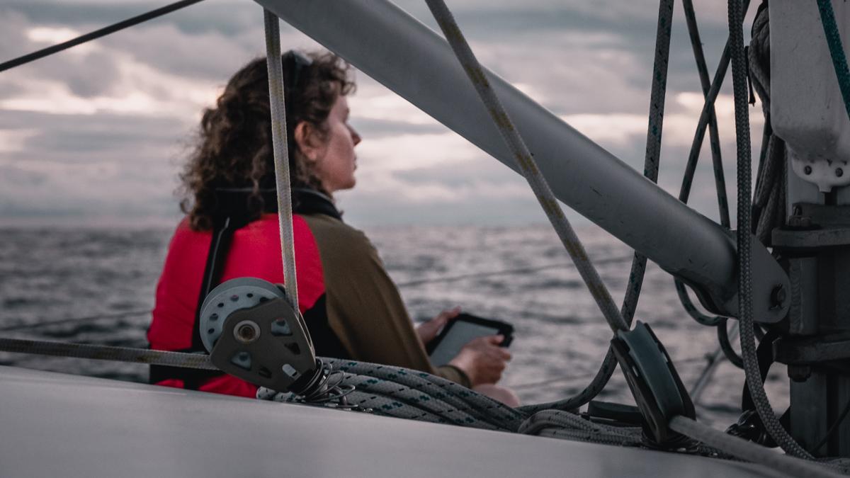 crew of sailing catamaran curiosity on passage to cook islands