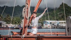 nikki wynn on traditional polynesian navigating sailboat in cook islands