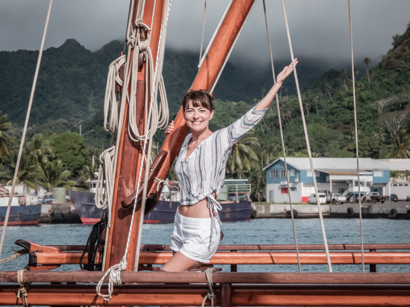 nikki wynn on traditional polynesian navigating sailboat in cook islands