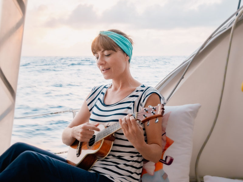 nikki wynn playing ukulele while sailing