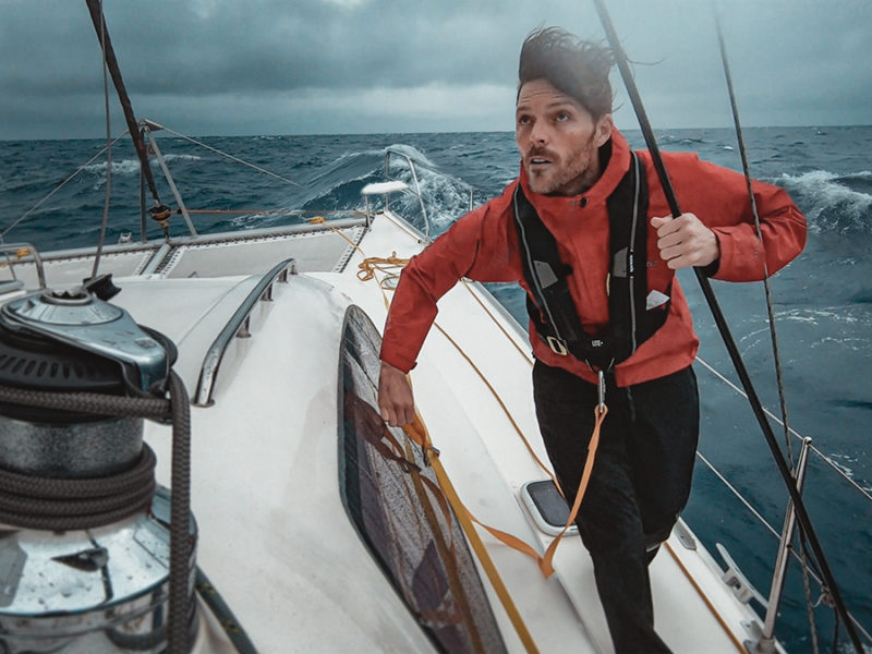 jason wynn sailing the south pacific on a catamaran in stormy seas