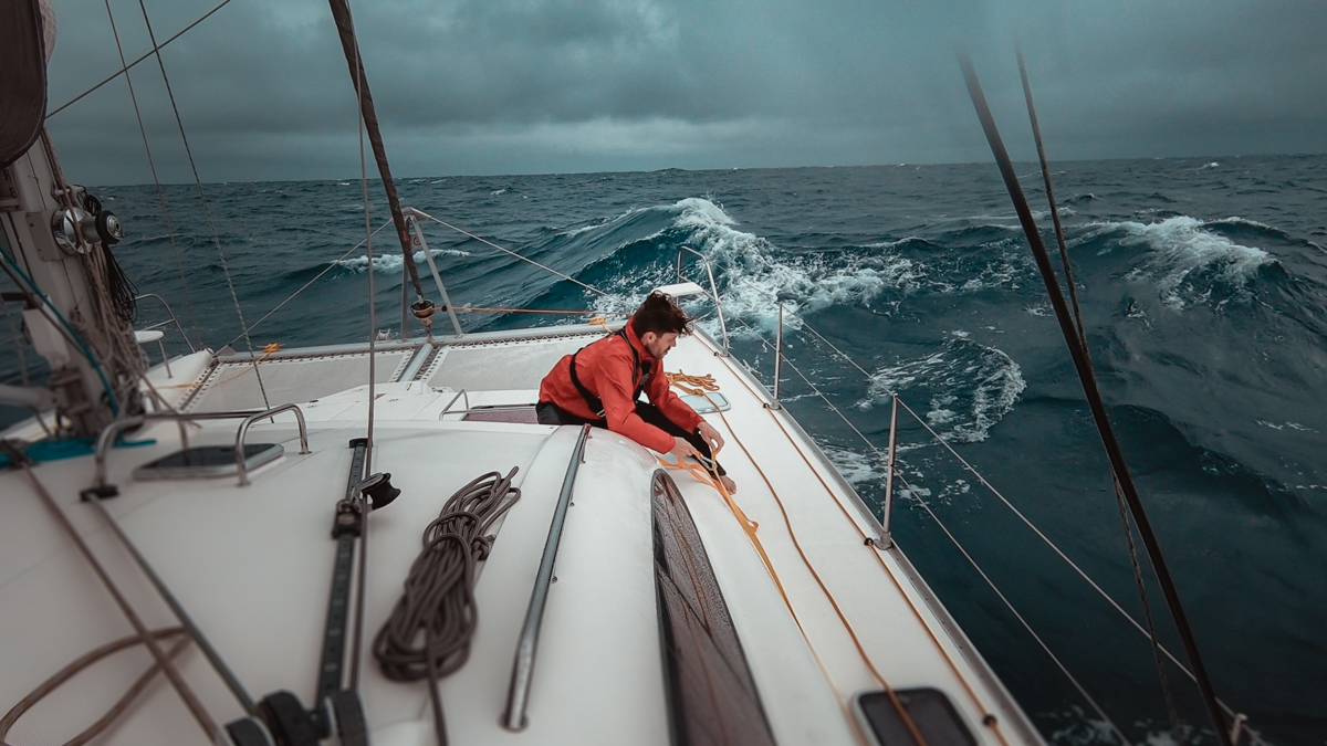 Jason Wynn battling waves in the south pacific aboard sailing catamaran curiosity