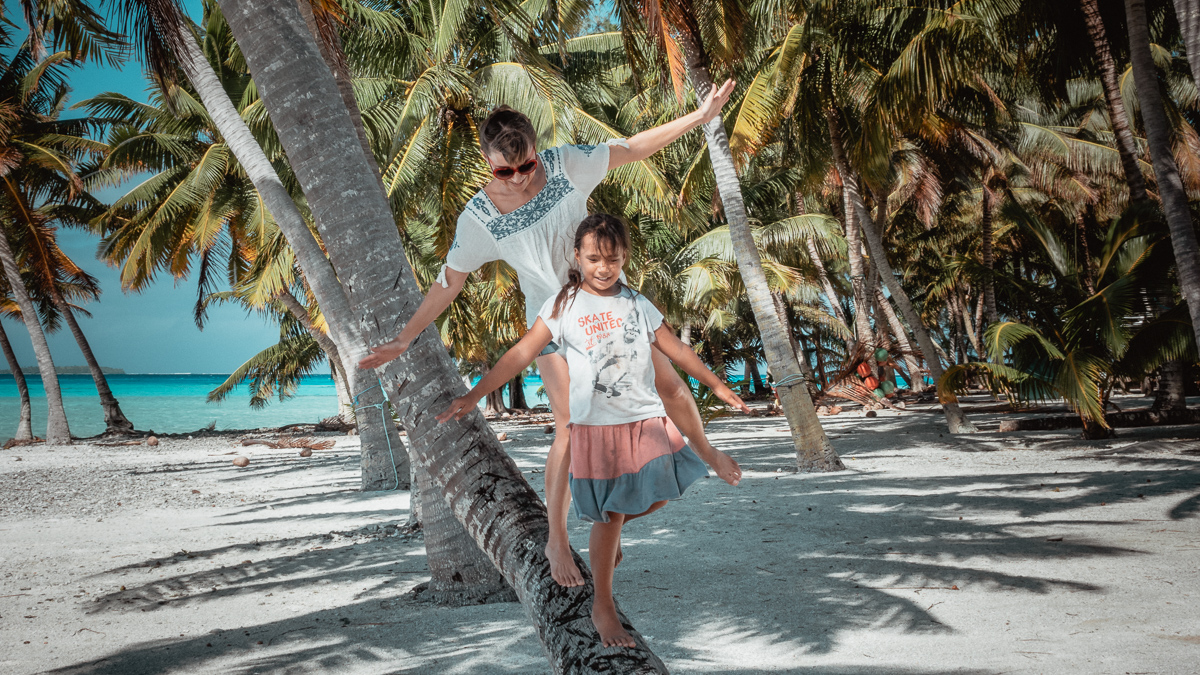 playing with island kids on remote island atoll of palmerson island, cook islands