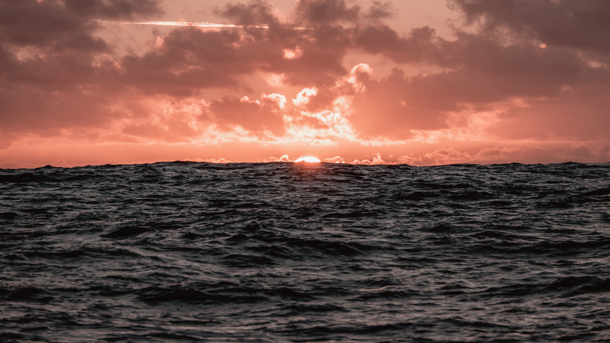 a golden sunset at sea in the south pacific
