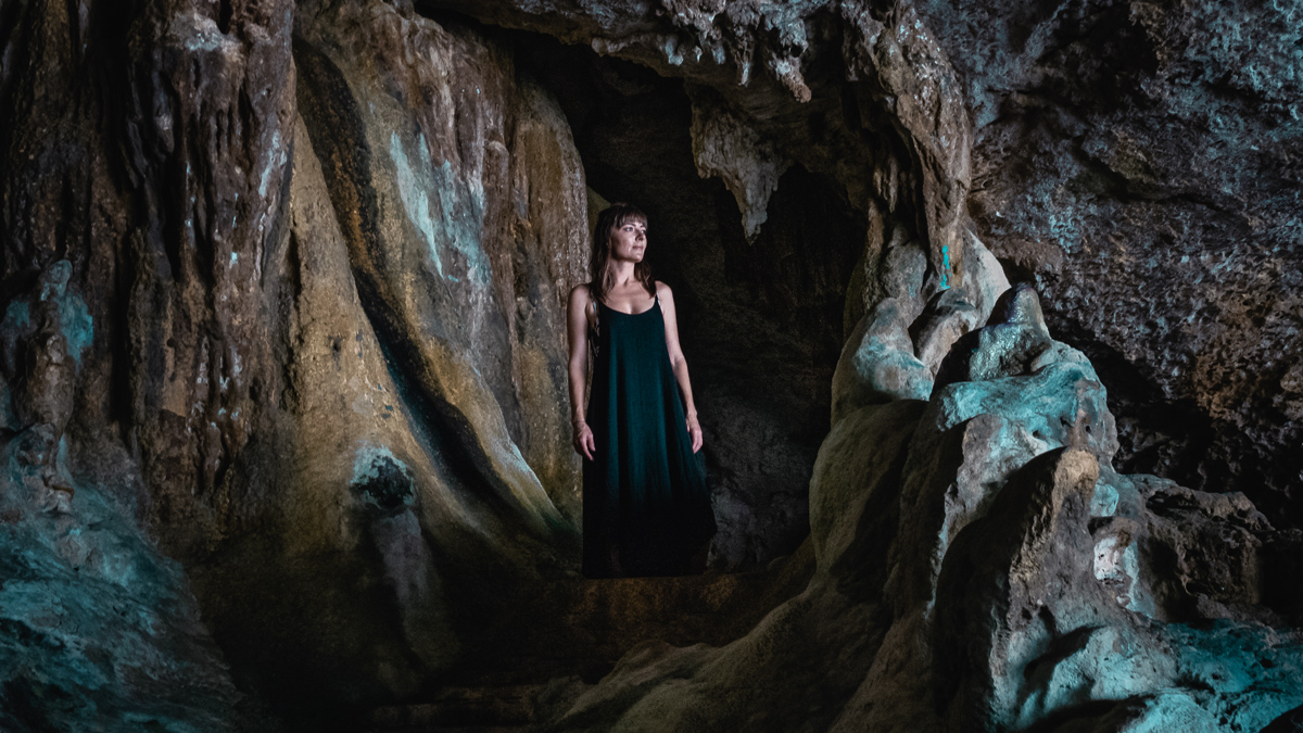 nikki wynn exploring caves in Niue in the south pacific
