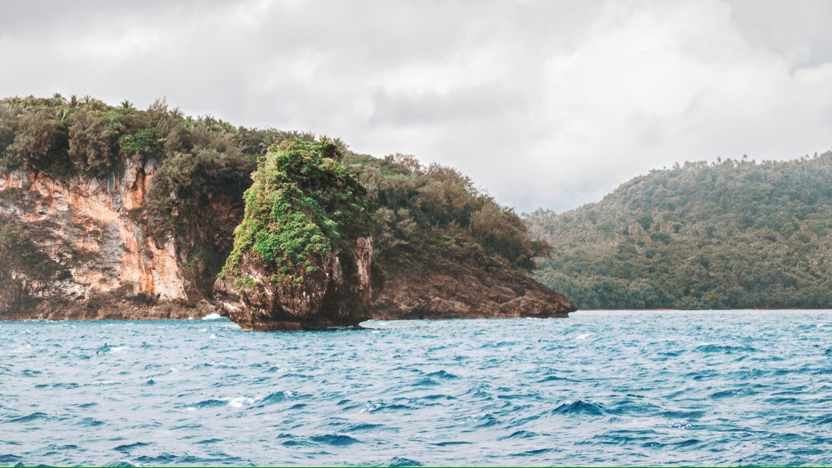 sailing into tonga with rocks and fog