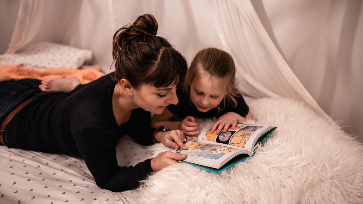 nikki wynn with niece reading a bedtime story