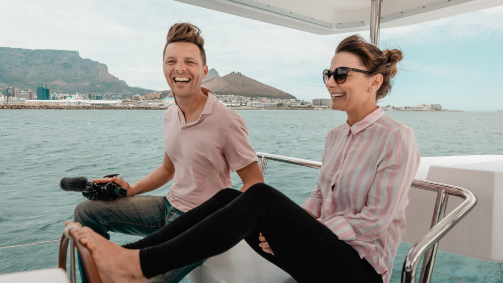 jason and nikki wynn at the helm of leopard catamaran in cape town south africa