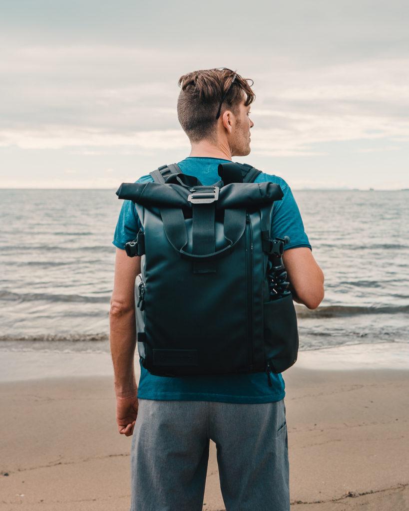 jason wynn with photography backpack at beach