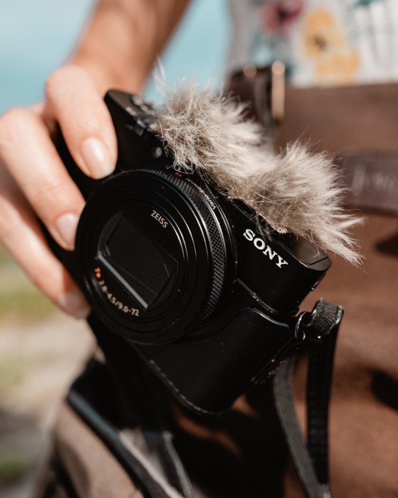 nikki wynn holding sony pocket camera