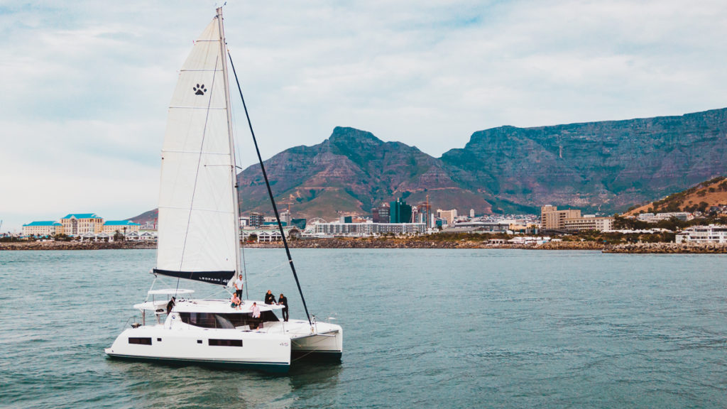 leopard 45 catamaran at sea with cape town south africa in background