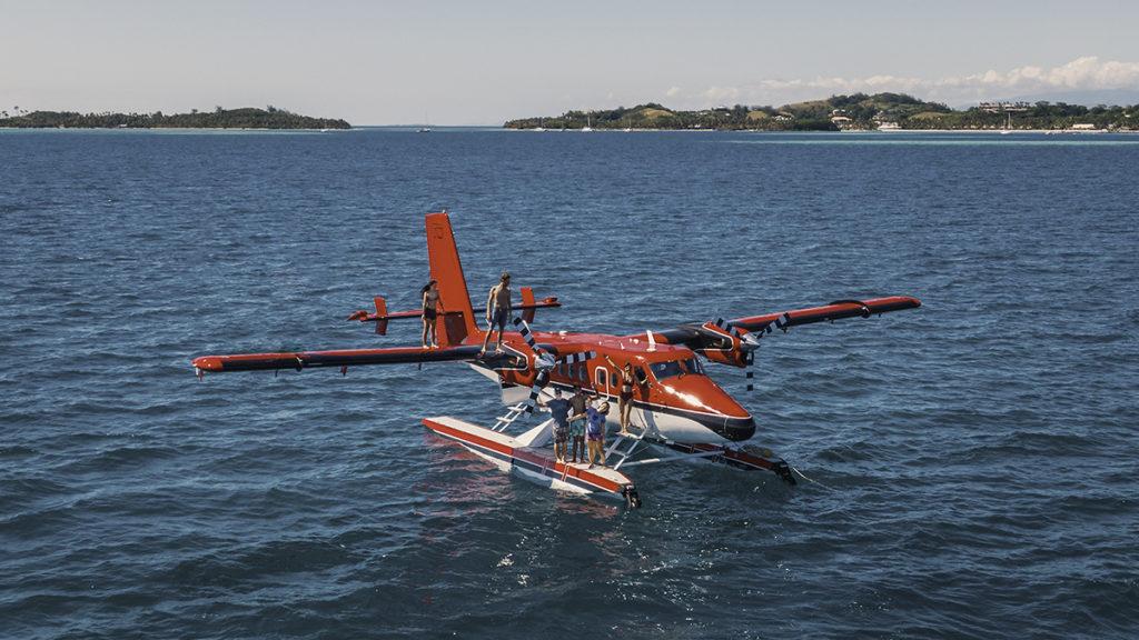 jason and nikki wynn with friends on asea plane adventures in fiji