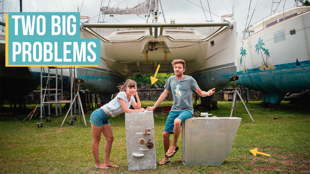 jason and nikki wynn in front of their sailboat curiosity with pitted out fuel tanks