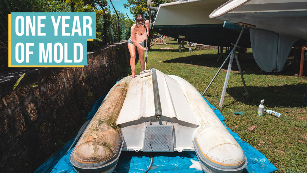 nikki wynn scrubbing the dinghy after one year of sitting on the hard
