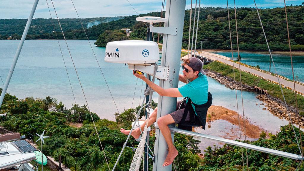 jason wynn working on the sailboat mast