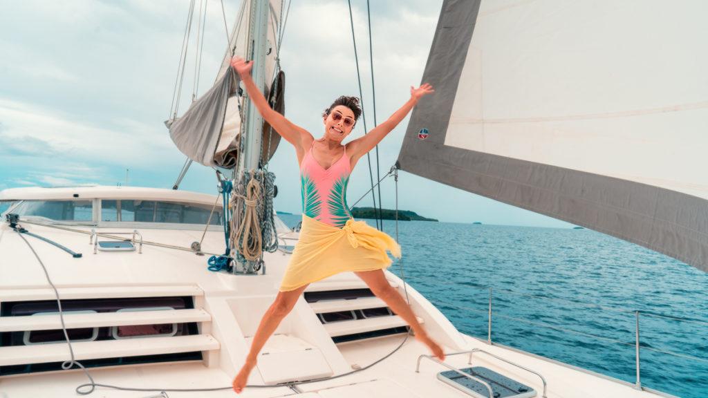 Nikki Wynn jumping for joy on the deck of sailing vessel curiosity