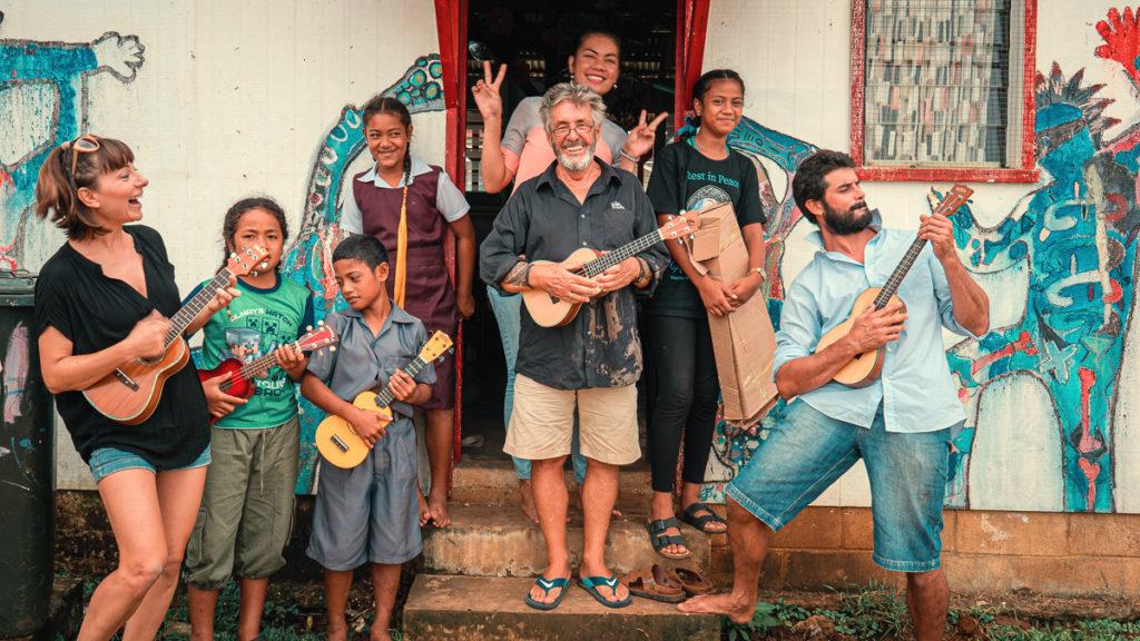 nikki wynn playing ukulele on a remote island in tonga