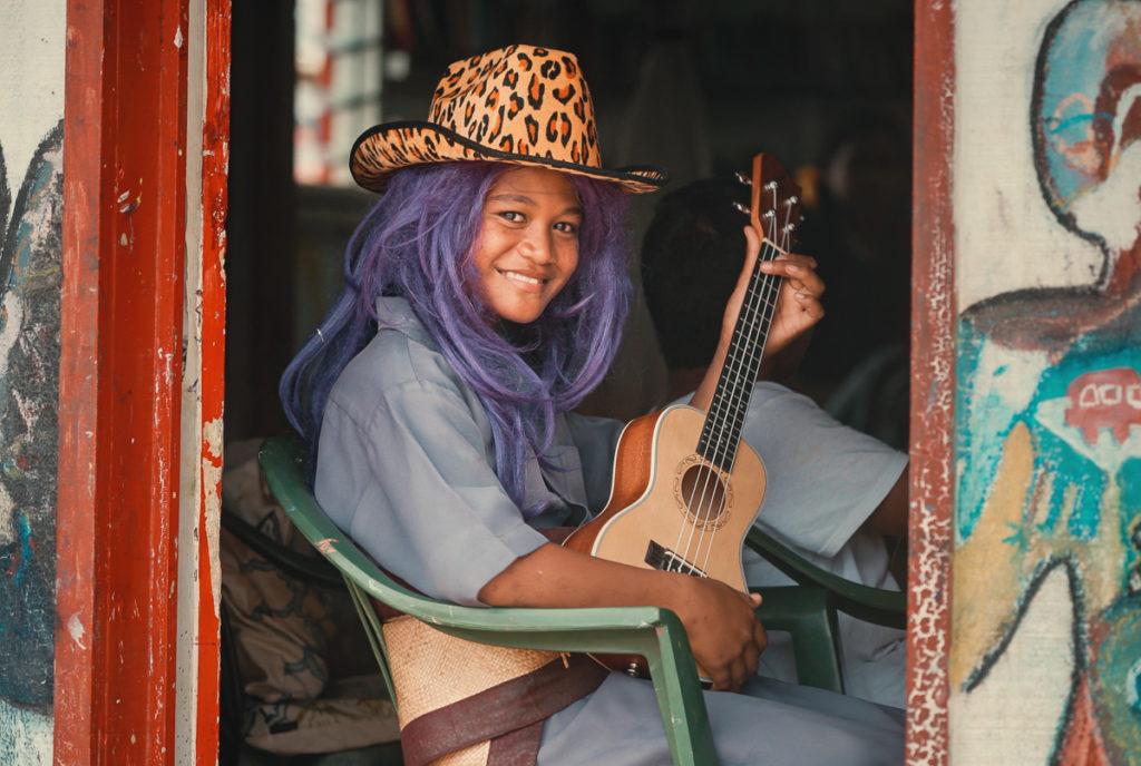 tongan kid learning to playing ukulele