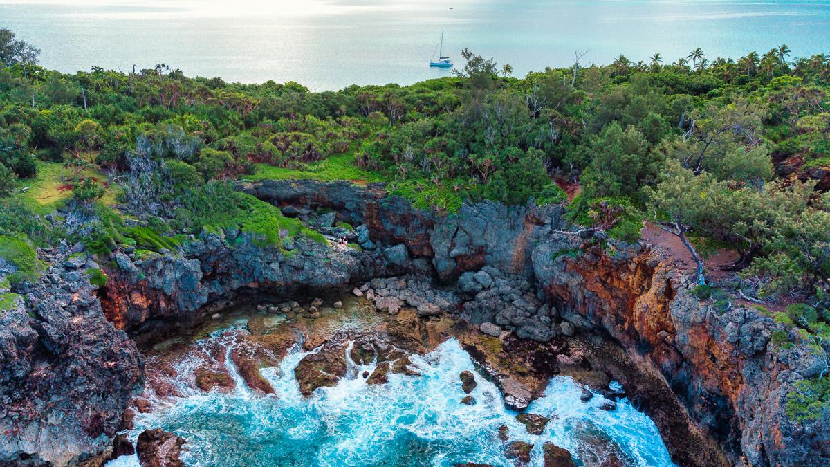 uninhabited island of kenutu with jason and nikki wynn and curiosity in the background