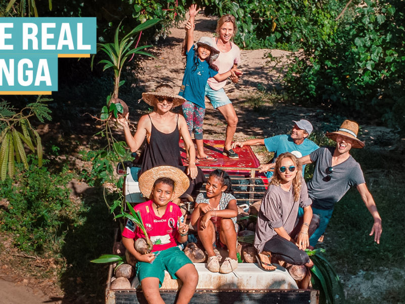 jason and nikki wynn with island villagers collecting coconuts